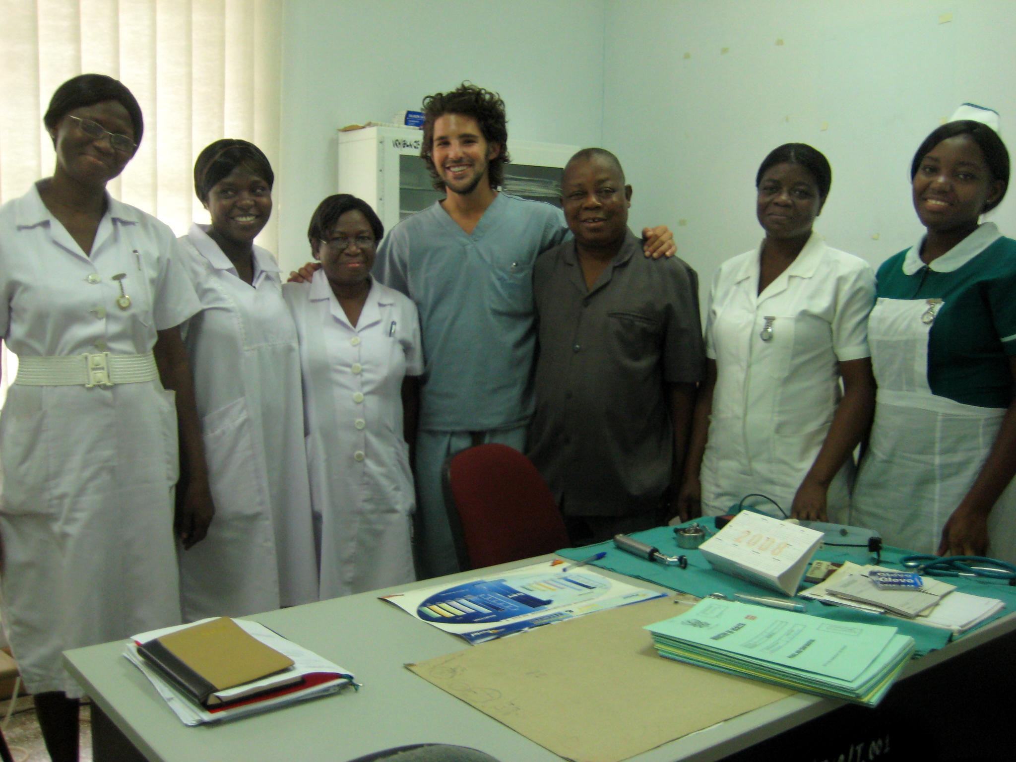 A few interns pose with local doctors and nurses at the end of their pharmacy internship in Ghana with Projects Abroad.